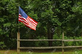 An American Flag On A Fence Post Blowing In The Wind On A Summer Stock Photo Picture And Royalty Free Image Image 12156333