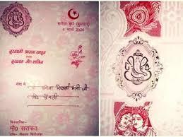 muslim man prints wedding card with