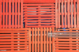 Orange Wooden Pallets Fence Background High Res Stock Photo Getty Images