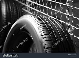 Car Tire Near Grate Fence Indoors Stock Photo Edit Now 1027226728
