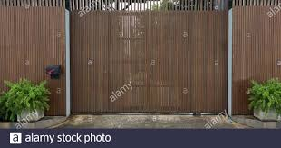 Wooden Garage Door Exterior Of Modern Home Background Giant Gate Fencing With Wood And Iron Slice With Wheel Stock Photo Alamy