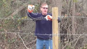 How To Use A Barbed Wire Stretcher While Building A Fence Youtube