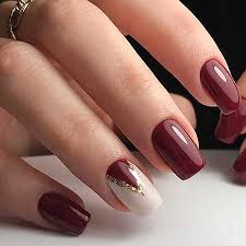 21 burgundy nails with gold glitter