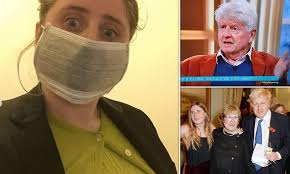 Lara Lettice dons surgical mask ...