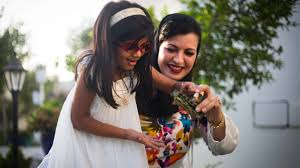 Ayesha Albusmait, and her daughter, Reem Abdullah Rashid. Albusmait is one  of the small, but growing number of single Emirati woman choosing to adopt.  | The World from PRX