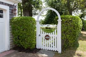 Rounded Arbor Cape Cod Fence Company In 2020 Garden Arbor With Gate Garden In The Woods Metal Garden Gates