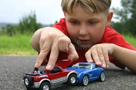 Crash. A boy playing with toy cars. Focused on the hands and toys , #Sponsored, #playing, #toy, #Crash, #boy, #hands #ad | Toy car, Boys playing, Boys