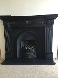 cast iron fireplace insert and wooden