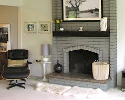 painted brick fireplace in a light gray