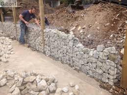 Gabion Wall Construction Fence Posts Set Between Gabions Http Www Gabion1 Com Gabion Retaining Wall Gabion Wall Sloped Backyard