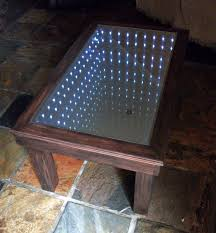 an infinity mirror coffee table