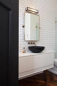pivot mirror with black bowl sink