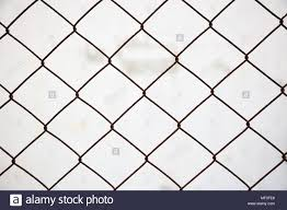 Wire Mesh Fence Made Of Steel With White Blurred Background Close Up View With Details Stock Photo Alamy