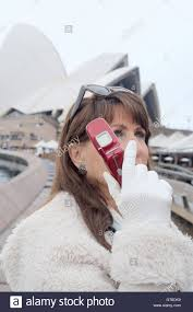 A woman uses Samsung T500 Mobile phone ...