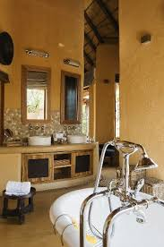 a washstand with mirrors against a