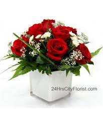 red rose in white cubic glass vase