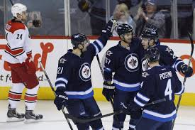 Adam Lowry scores first NHL goal to power Jets over Hurricanes - The Globe  and Mail