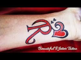 r letter tattoo with love heart