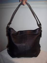 coach black pebble leather duffle hobo