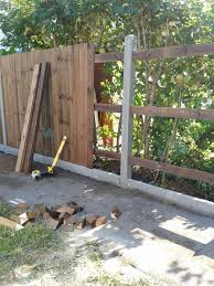 Construction Of Close Boarded Fence With Concrete Posts And Gravel Boards Concrete Fence Posts Diy Fence Fence Design