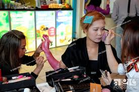 artists applying body paint and make up