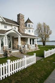 12 Charming Picket Fence Ideas Town Country Living Front Yard Fence Picket Fence Fence Design