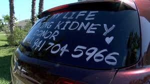 Tampa Bay Area Man Advertising Need For Kidney On Car Window