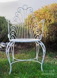 white metal garden chair photograph by