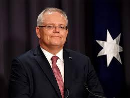 Australian PM Scott Morrison greets ...