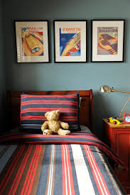 Coast To Coast Movers Eclectic Kids And Bedroom Bedside Table Boys Room Framed Art Headboard Kids Rooms Painted Walls Red Swing Arm Lamp West Coast Blue Wood Bed Frame Finefurnished Com