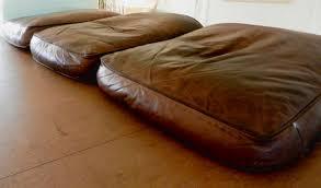 flattened down leather sofa cushions