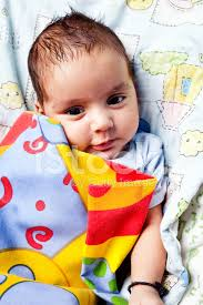 cute cheerful indian baby boy infant in