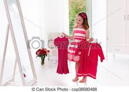 choosing dresses in white bedroom