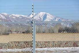 Electric Fencing Used As Perimeter Security In A Remote Outdoor Loaction In The Mountains Security Fence Electric Fence Perimeter Security