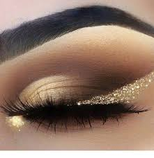 nice black and gold eye makeup with glitter