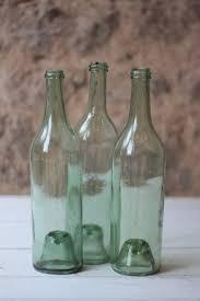 antique green glass burdy bottles
