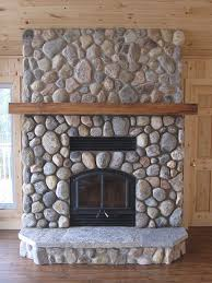 wood burning fireplace with river stone