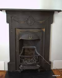 remove rust from a cast iron fireplace