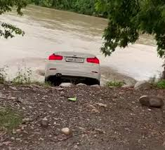 man pushes birthday gift bmw into river