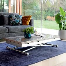 rise extending coffee table stone dwell