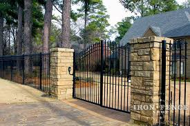 Our Arched Aluminum And Iron Driveway Gates Pair Nicely With Stone Columns And Pillars Iron Fence Aluminum Fence Aluminum Driveway Gates