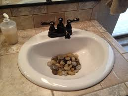 river rocks in the bathroom sink a
