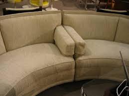 large pair of semi circular sofas in