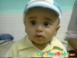 round face eyes baby boy with cap