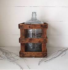vintage 5 gallon water bottle in crate