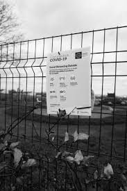 Grayscale Photo Of White Cardboard Box On Metal Fence Photo Free Black And White Image On Unsplash
