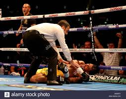 Aaron Morgan is knocked down by Joe Pigford (not pictured) during the Stock  Photo - Alamy