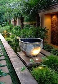 pavers stone path large urn grasses