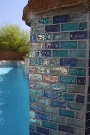 glass tile surrounds the pool