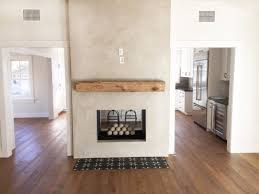 double sided fireplace gray stucco